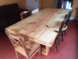 Live edge pine dining table with fir center by Artisan Woodworks